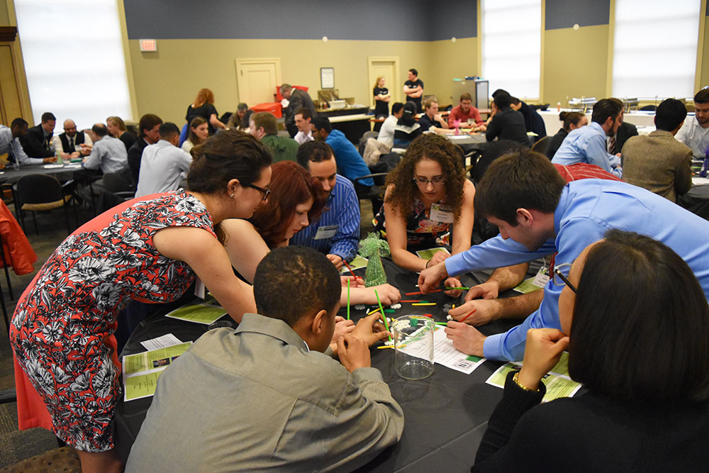 """Tables competed in a """"Race To Taste"""" competition where they had to build a structure with Kinnex. Left to right: Cam Hansel, Emily Bousaada, Chelsea Henderson, Shawn Fonseca (former UCMA president and alumnus), Alexandra Merkouriou (former UCMA president 2013-2015 and alumna), Benjamin Barard."""