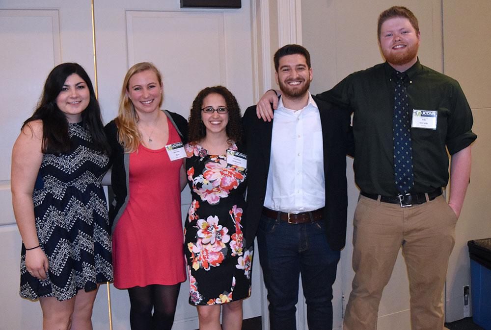 Alumni Lauren Salisbury, Rheanna Ward, Alexandra Merkouriou, Joey Pacheco, and Luke McCarthy catching up at the banquet.